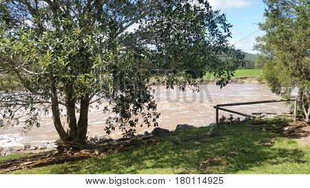 Flood Waters at the Coomera River Weir Oxenford Queensland AUSTRALIA