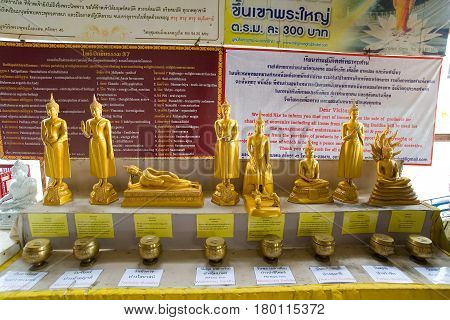 Phuket Thailand February 1 2017: Eight statuettes of golden Buddhas. Photographed on the territory of the Temple Greater Buddha.