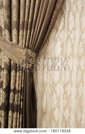 Part Of Beautifully Draped Curtain On The Window In The Room. Close Up Of Piled Curtain. Luxury Curt