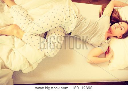 Sleepy Woman Sleeping In The Bed.