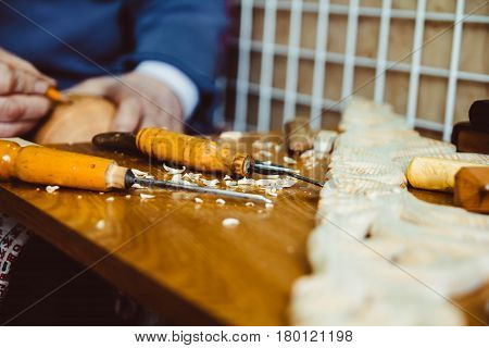 Tool carpenters in the workshop of the wood Carver are on the table