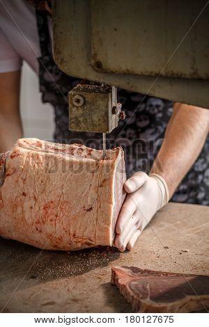 Worker Cuts Beef Meat