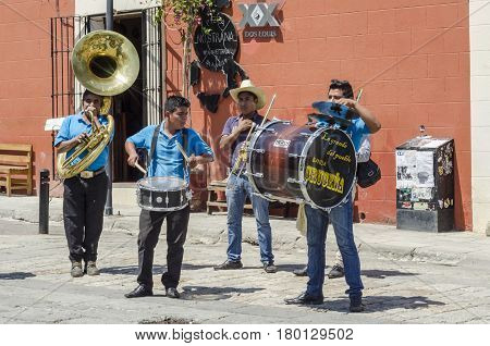 OAXACA, MEXICO- MARCH 10, 2017: Street musicians playing at downtown in Oaxaca, Mexico