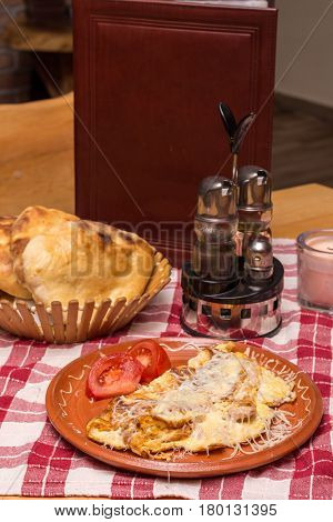 Omelet With Cheese Served And Arranged