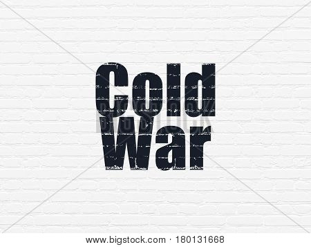 Political concept: Painted black text Cold War on White Brick wall background