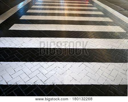 Crosswalk on asphalt road surface in Thailand.