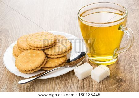 Cup Of Tea, Cookies In Plate And Lumpy Sugar