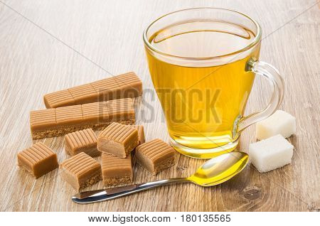Cup Of Tea, Creamy Toffee, Lumpy Sugar And Spoon