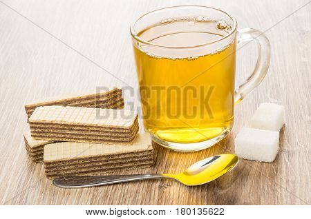 Cup Of Tea, Wafers, Lumpy Sugar And Spoon