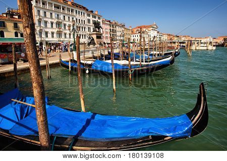 Venice, Italy - July 27, 2012: Gondola harbor in front of Grand canal entrance in Venice city.