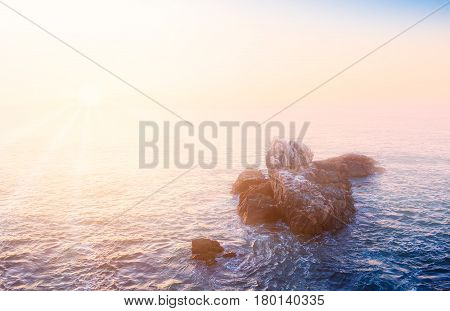 Evening view of pacific ocean in Vina del Mar Chile with sea rocks on the foreground