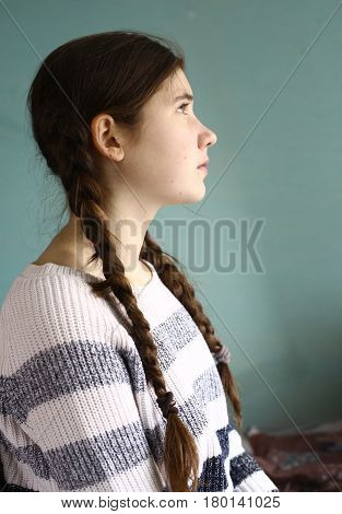 Teen Girl With Long Plaits Half Face Close Up Portrait
