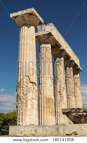 columns to temple of Aphaia in Greece Island on background blue sky