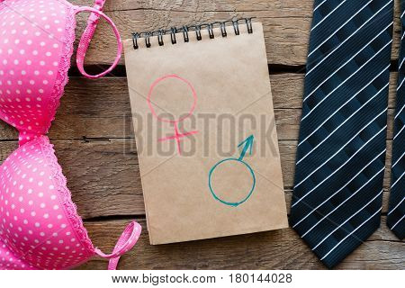 Male And Female Accessories And Gender Symbols In A Notebook