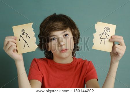 Teenager Boy Hold Mom And Dad Drawing In Two Torn Paper Pieces