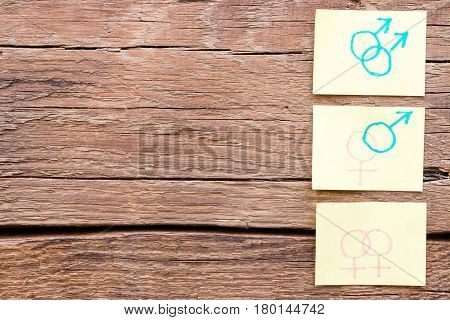 Hand Drawn Gender Symbols On Paper On A Wooden Background Space For Text