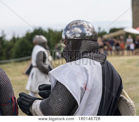 Loarre, Spain - July 09, 2016: Medieval reenactment with costumed characters and medieval armor with chainmail, helmet swords and shields.