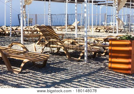 Beach loungers under a canopy on a sunny day