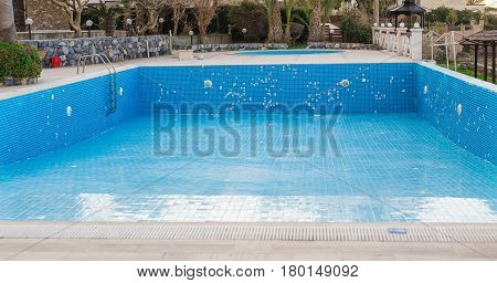 A swimming pool empties at the end of tourist season