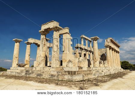 old temple on the Island of Aegina in Greece on blue sky background