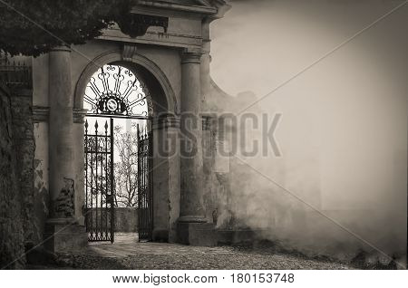 A door of an old Italian building a sight that symbolizes the required step that sometimes needs to be done to change their lives according to what can lead us to happiness.