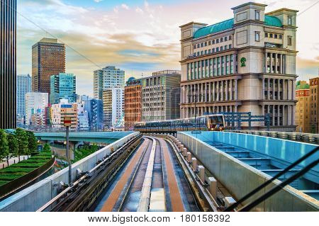 TOKYO, JAPAN - OCTOBER 02, 2015 : Tokyo monorail transportation system line in Odaiba. View from moving car.