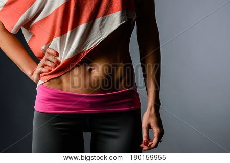 Closeup studio shot of sporty muscular female torso
