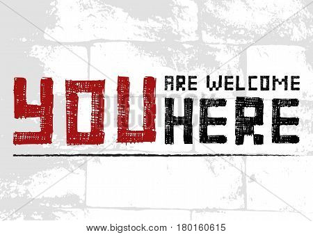 Salutatory card with stylized caption You are welcome here in grunge style on pale brick masonry background. Vector illustration