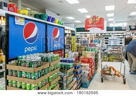 Saint Martin Dutch Antilles March 18 2017: Soft drinks produced by Pepsi Cola stand on the floor of a supermarket under a Pepsi sign.