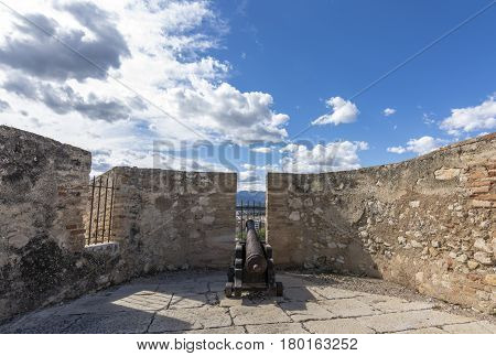 Rusted iron canon mounted on top of the Castell de la Suda in Tortosa, Spainn old fort. The castell de la Suda, also known as the Suda of Tortosa, is one of the main historical monuments of the city of Tortosa