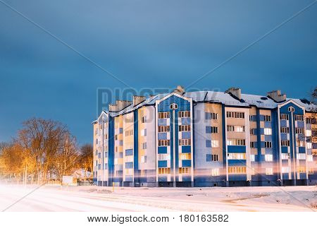 Multi-storey House In Residential Area At Winter Evening Or Night.