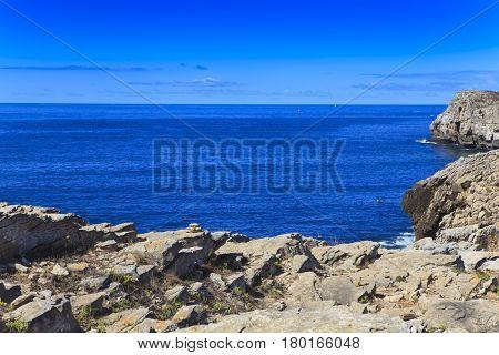 Rocky Coast Extending into the Sea .