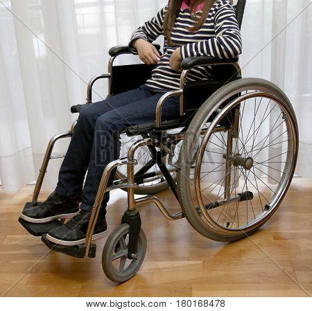 Paraplegic Young Girl In A Wheelchair