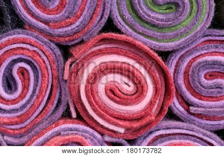background rolls of cloth and felt for sale in the shop for amateur tailors