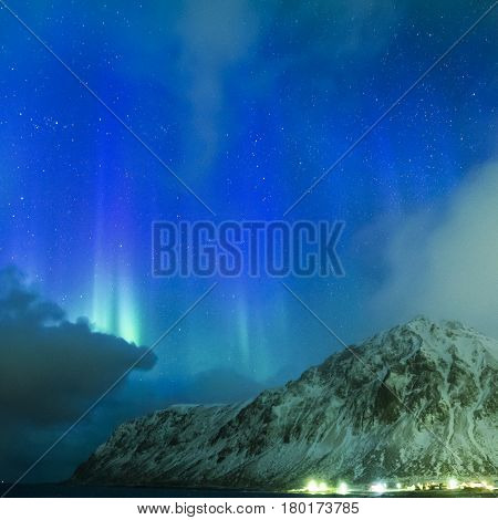 Amazing Picturesque Unique Nothern Lights Aurora Borealis Over Lofoten Islands in Nothern Part of Norway. Over the Polar Circle. Square Image Composition
