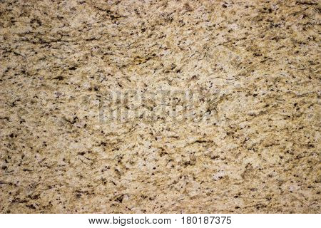 Yellow marble wall with dark stones background for design