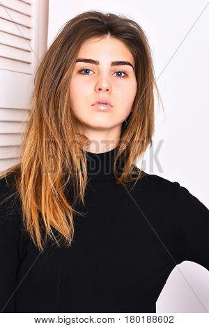 Pretty Cute Sexy Caucasian Girl Posing In Black Turtleneck
