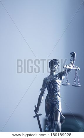 Law offices of lawyers legal statue Greek blind goddess Themis bronze metal statuette figurine with scales of justice.