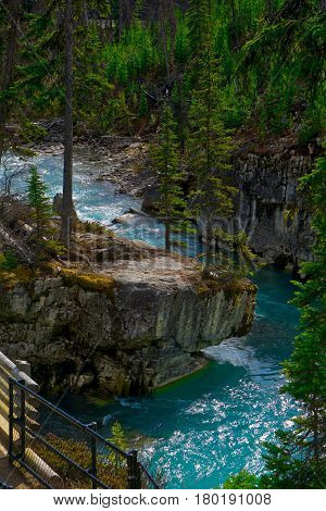 The teal waters in Marble Canyon, Canada