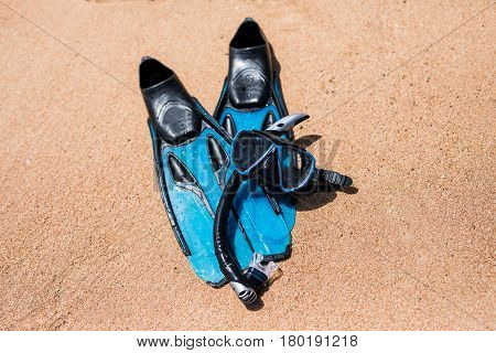 Beach Vacation Fun Snorkel Equipment On Sand With Ocean Waves Splashing Water. Scuba Diving And Snor