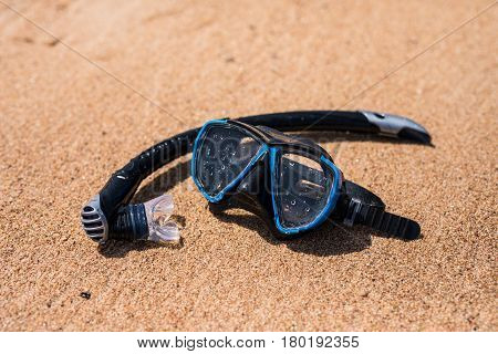 Holidays Background. Diving Mask And Flip-flops On The Ocean Beach