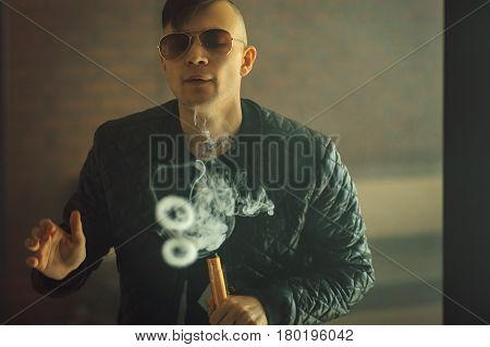 Vape. Young Handsome White Guy Let Rings Out Of Steam. Vaping.