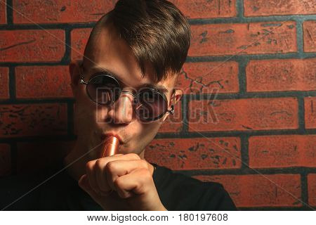 Vape. Young Handsome White Guy With Electronic Cigarette. Vaping.