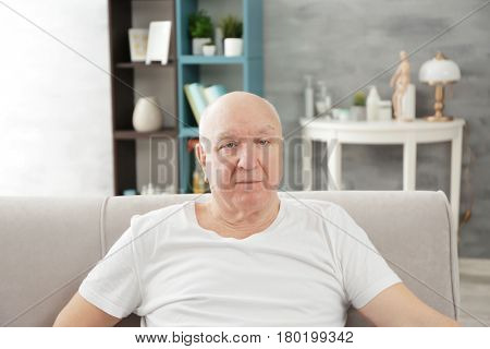 Senior bald man at home