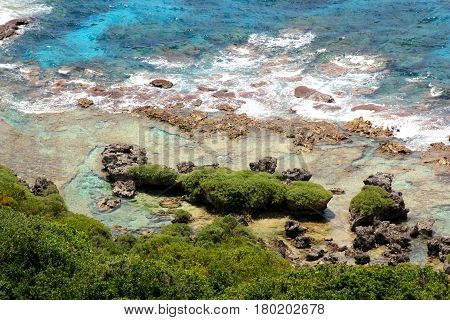 Shoreline islets, Rota  Dramatically formed islets decorate a rocky shoreline in Rota, Northern Mariana Islands