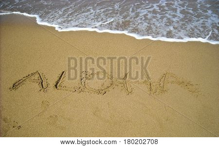 This is a photo of text in sand.