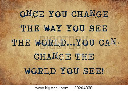 Inspiring motivation quote with typewriter text once you change the way you see the world...you can change the world you see. Distressed Old Paper with Typing image.