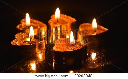 Burning candles. Candles light background. Candle flame at night.