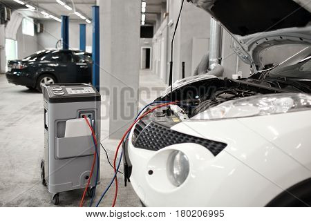 Mechanic work in automobile shop, repair climate on car.