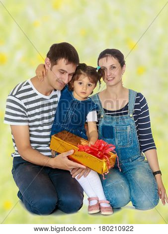 Happy young family with little daughter cuddling together in celebration of Christmas. white green blurred background.
